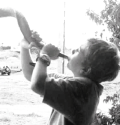 boy blowing horn